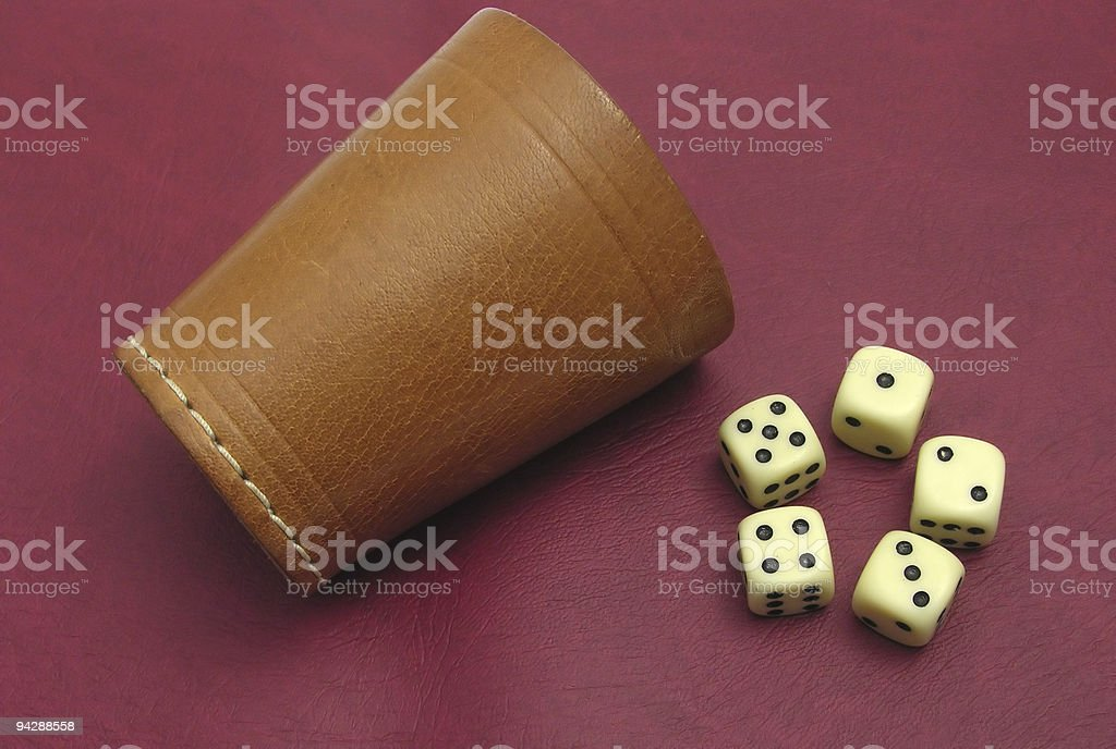 Cup with dice stock photo