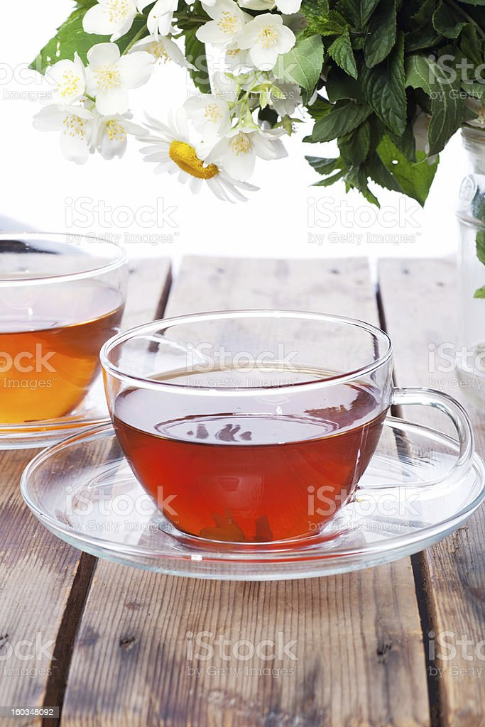 Cup with green tea and fresh herbs royalty-free stock photo