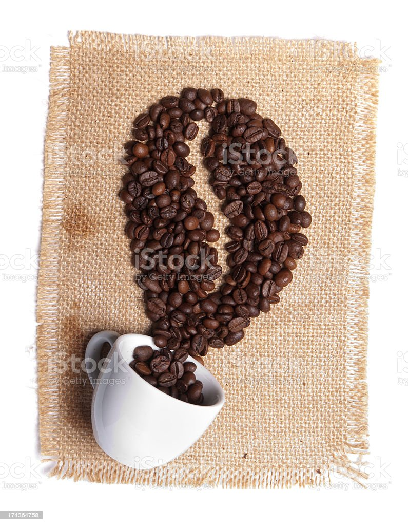 cup with heap of coffee grains on burlap background royalty-free stock photo