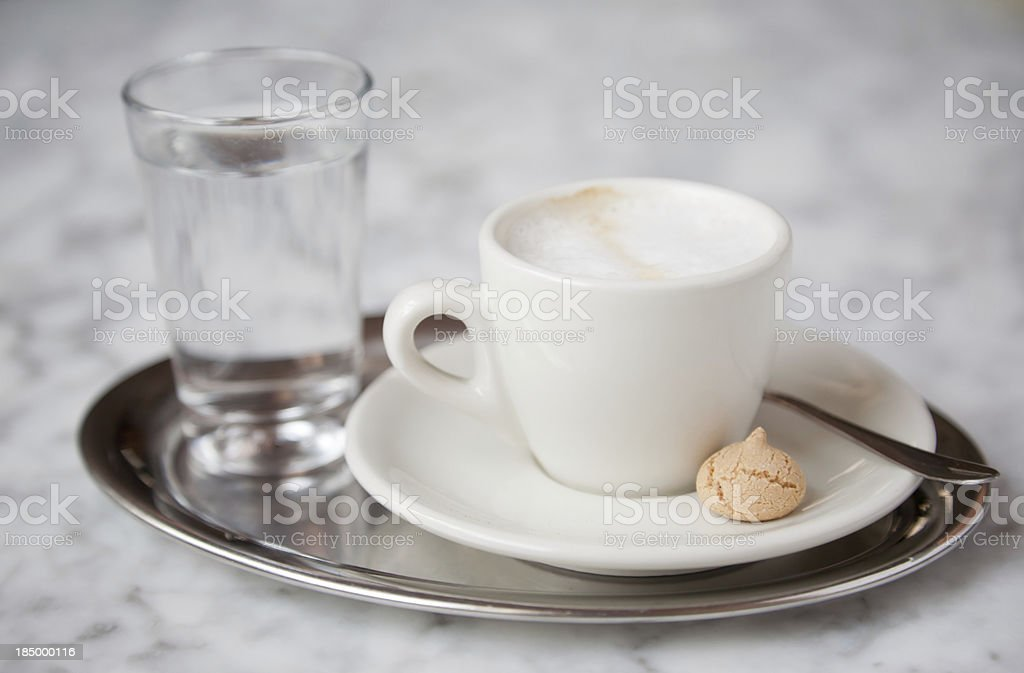 Cup with Italian Espresso served and a glass of water royalty-free stock photo
