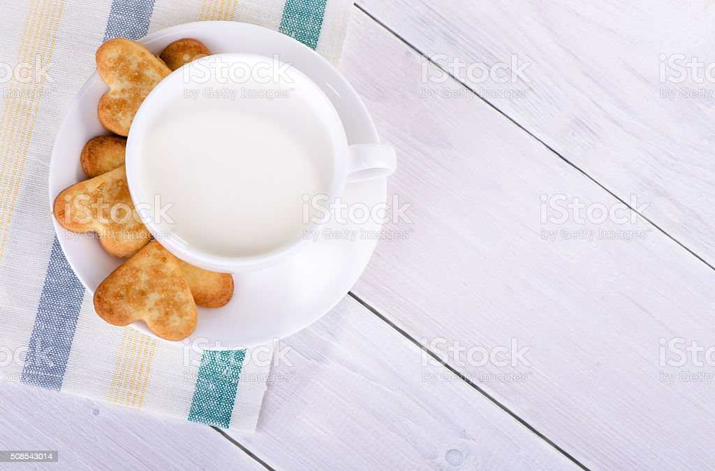 Cup with milk and cookies in the shape stock photo