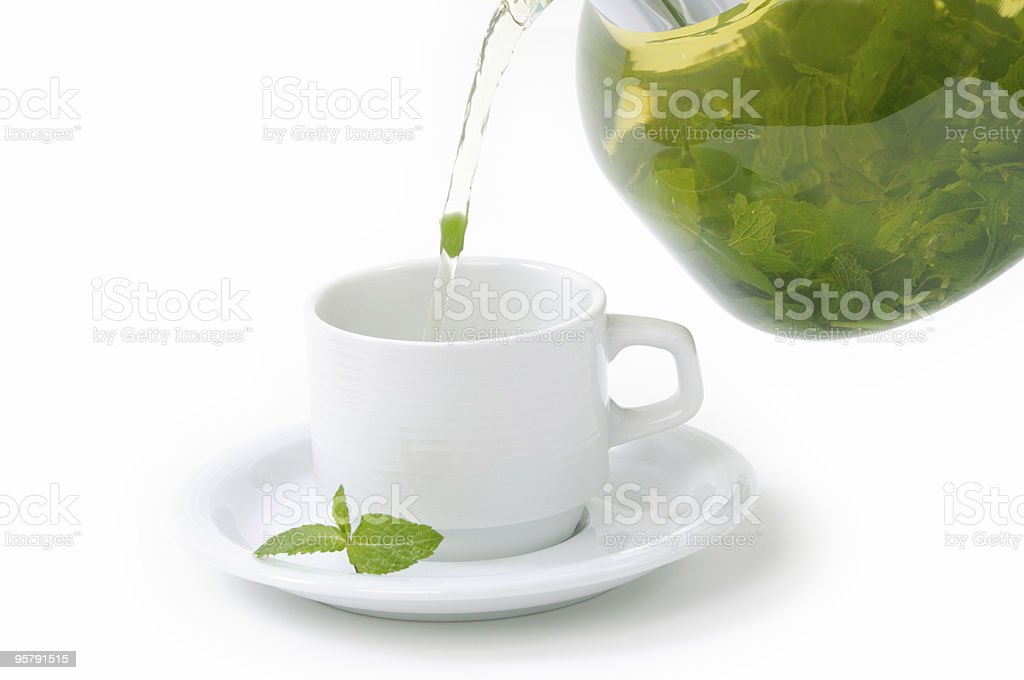 Cup with mint tea and teapot royalty-free stock photo
