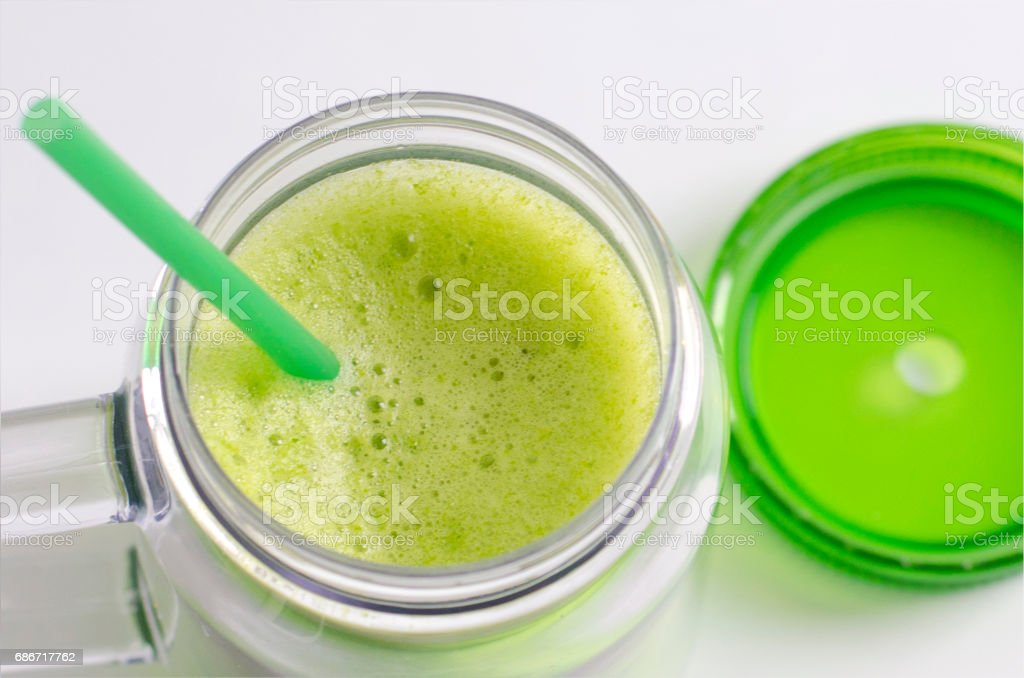 Cup with smoothie with lid stock photo