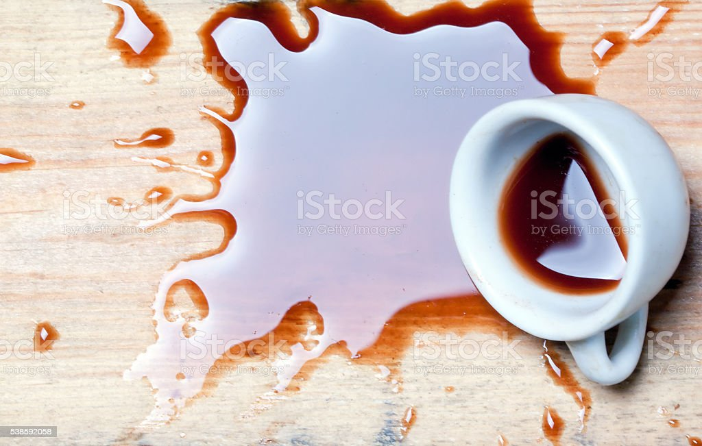 cup with spilled coffee stock photo