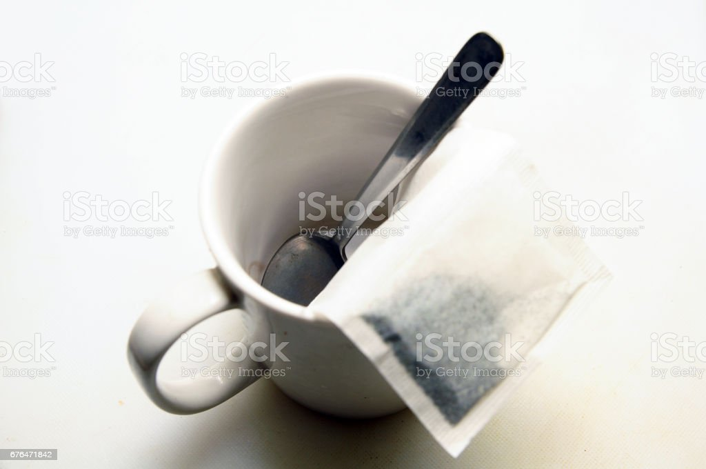Cup with tea for cooking stock photo