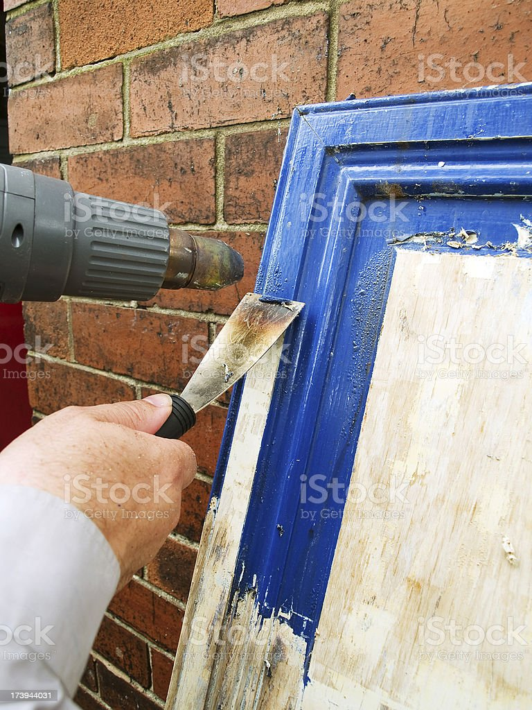 Cupboard door blue paint removal royalty-free stock photo