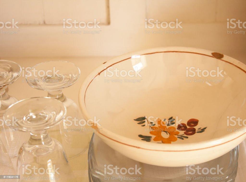 Cupboard Shelf: Vintage Bowl, Dishes, Wine Glasses stock photo