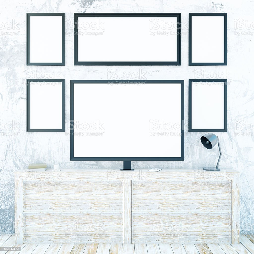 Cupboard with monitor and frames stock photo