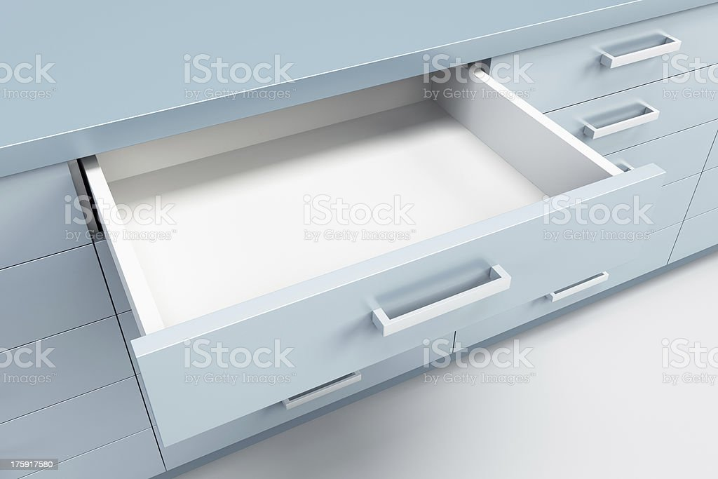 cupboard with opened drawer stock photo