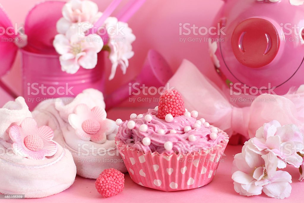 Cupcake and baby decoration in pink color royalty-free stock photo