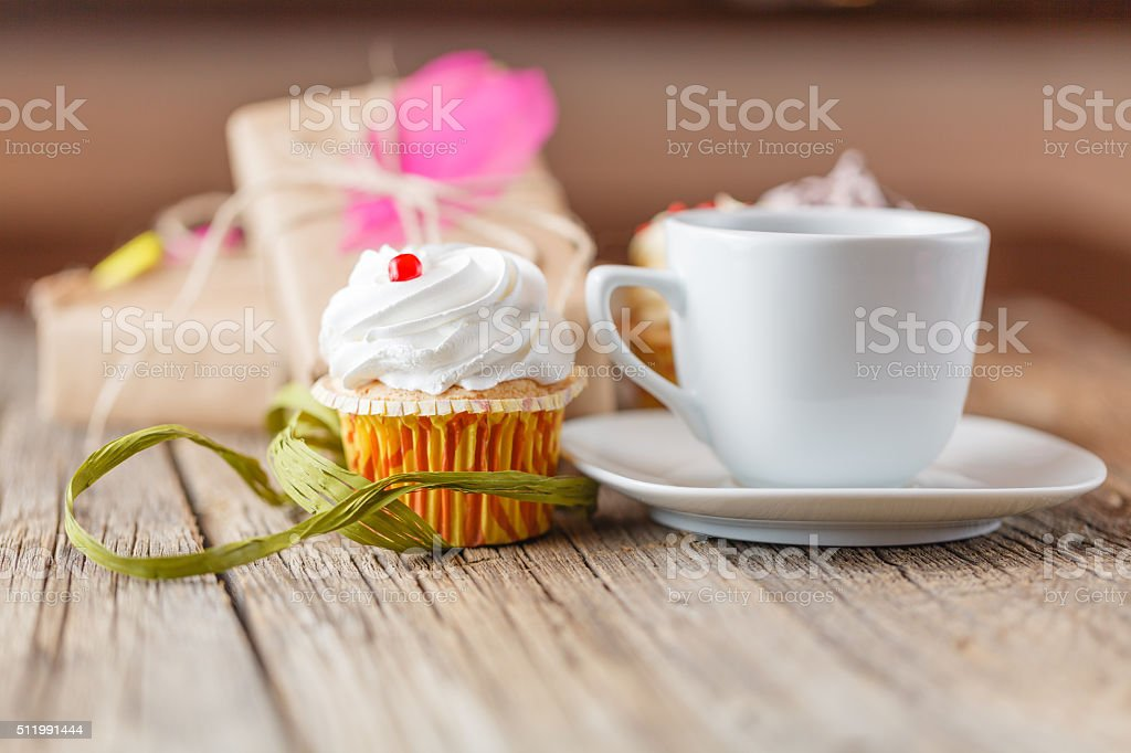 cupcake and cup of coffee stock photo