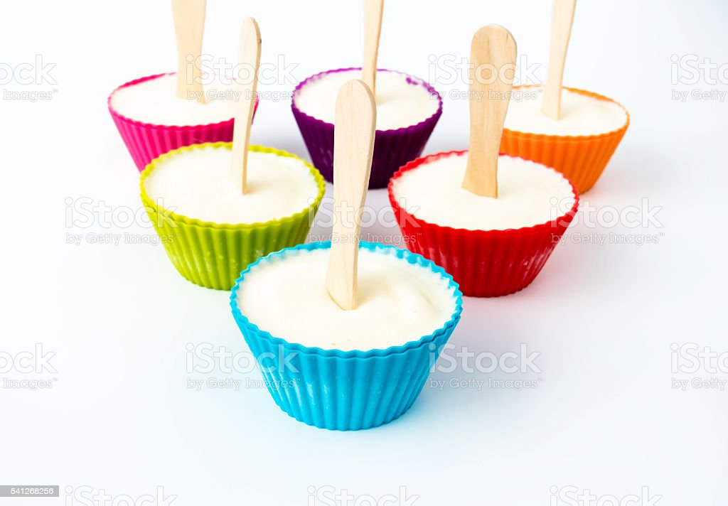 Cupcake Cases filled with Vanilla Ice Cream stock photo