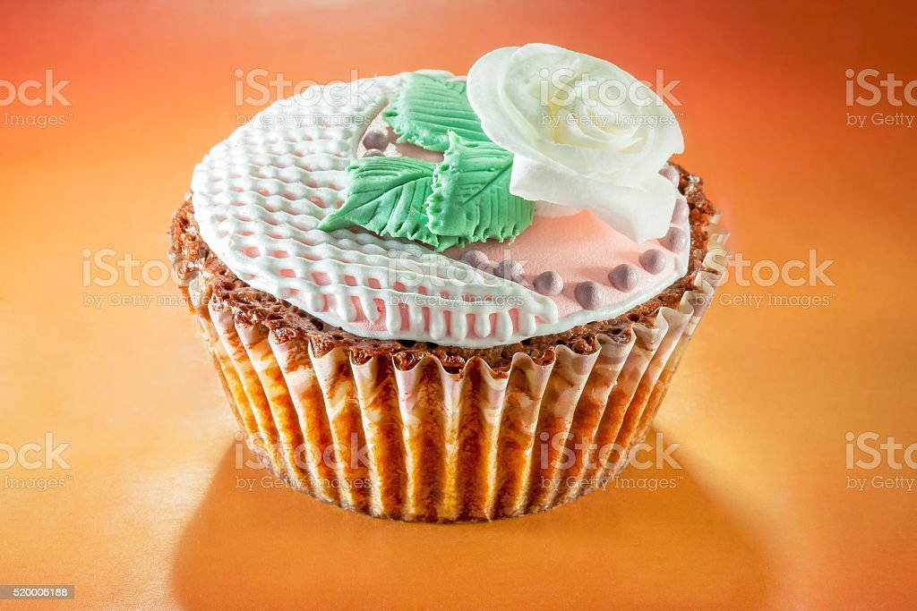 Cupcake decorated with with rose stock photo