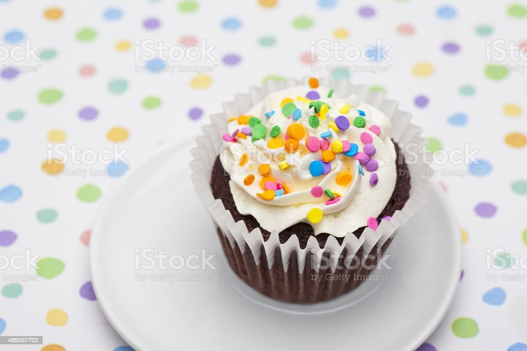 cupcake garnishes with sprinkles served in a plate stock photo