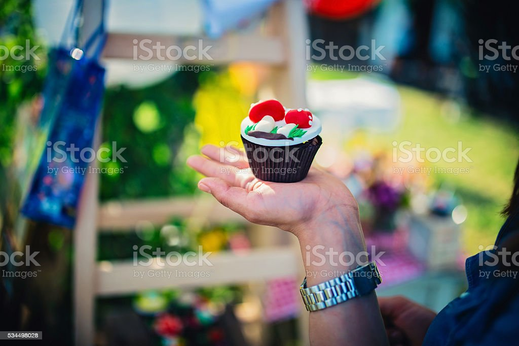 Cupcake in girls hand stock photo