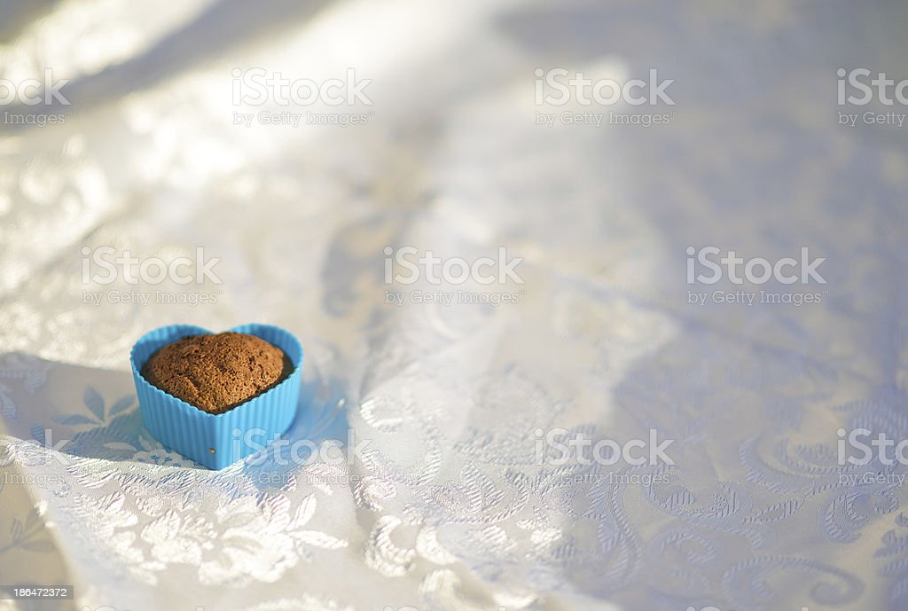 Cupcake in the shape of a blue heart royalty-free stock photo