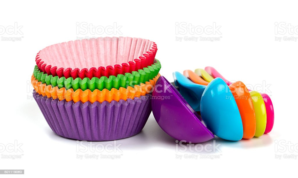cupcake liners and measuring spoons stock photo