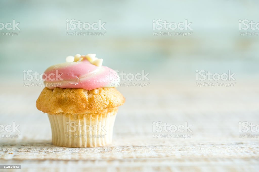 cupcake on the old wooden stock photo