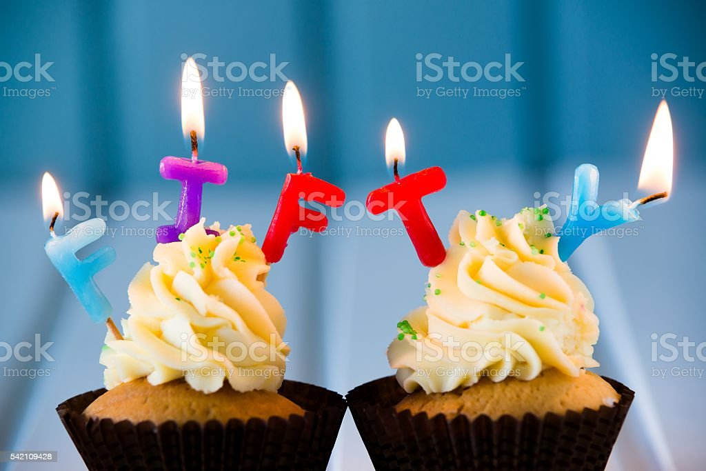cupcake with a candles for 50 - fiftieth birthday stock photo