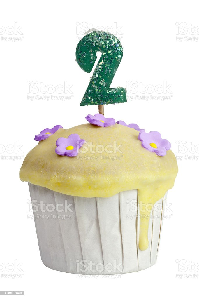 Cupcake with birthday candle for two year old royalty-free stock photo