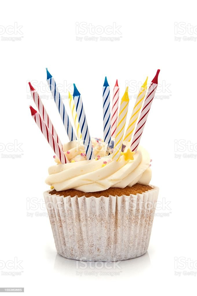 A cupcake with birthday candles stock photo