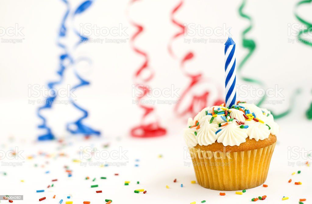 Cupcake with candle sprinkles and ribbons stock photo