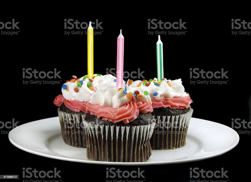 Cupcake with Candles on Black royalty-free stock photo