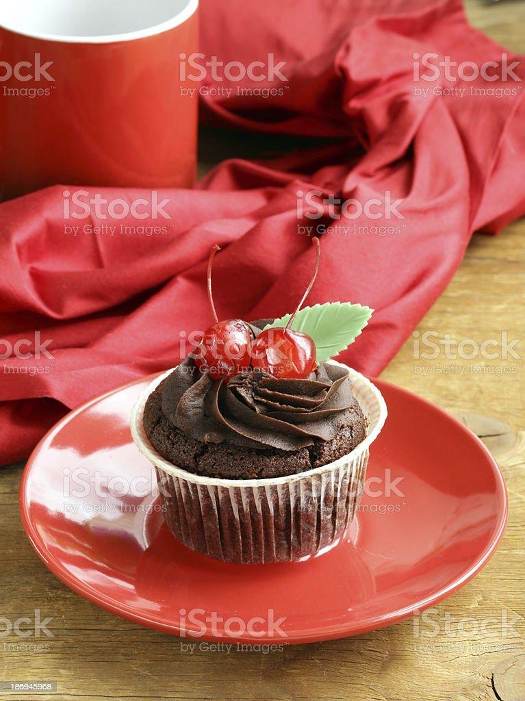 cupcake with chocolate ganache  and cherries royalty-free stock photo