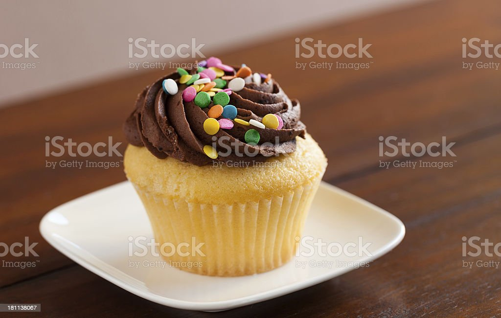 Cupcake with chocolate topping royalty-free stock photo