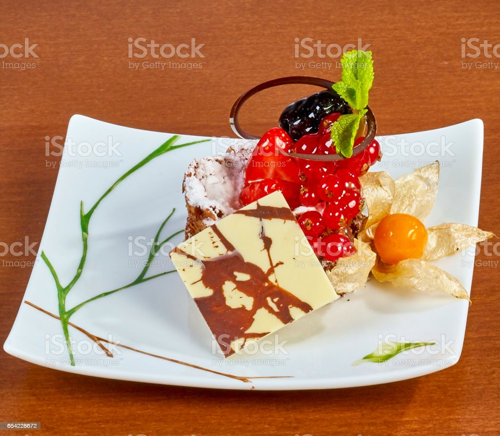 Cupcake with fresh fresh berries decoration on the table stock photo