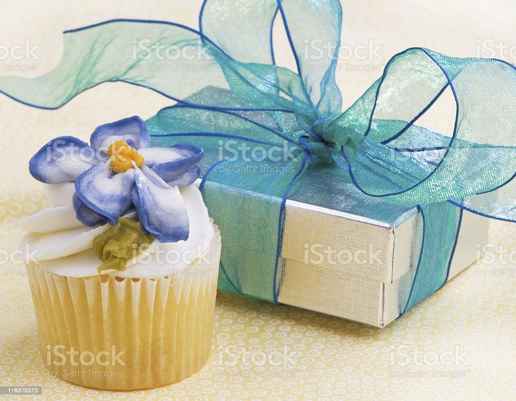 Cupcake With Gift On Yellow royalty-free stock photo