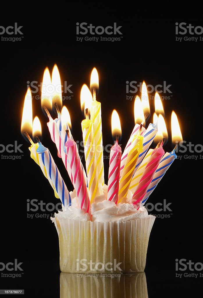 Cupcake with lots of lit candles royalty-free stock photo