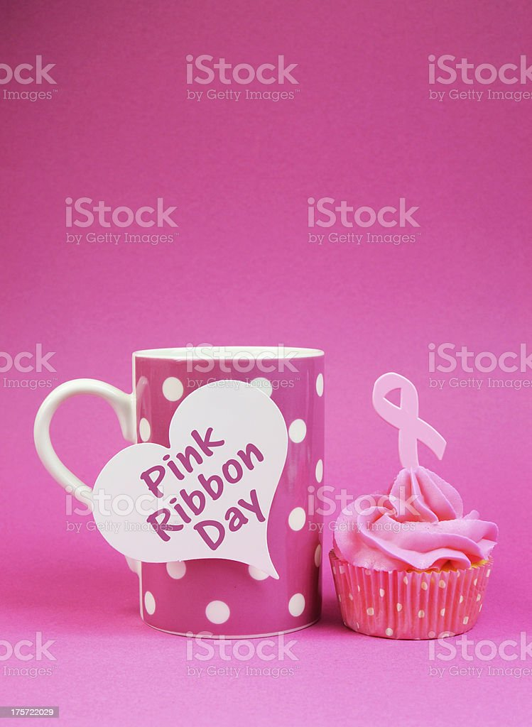 Cupcake with Pink Ribbon Day message on polka dot cup. royalty-free stock photo