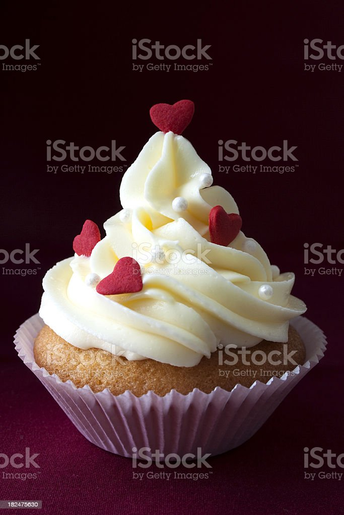Cupcake with red hearts. stock photo