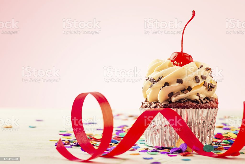 Cupcake with red ribbon royalty-free stock photo