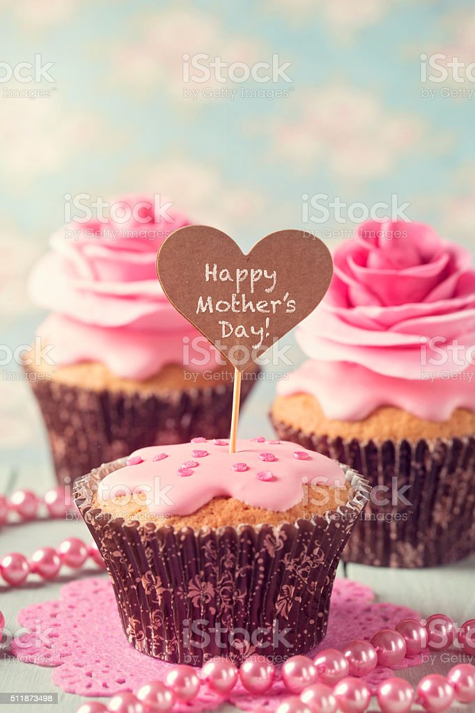 Cupcake with rose flowers stock photo