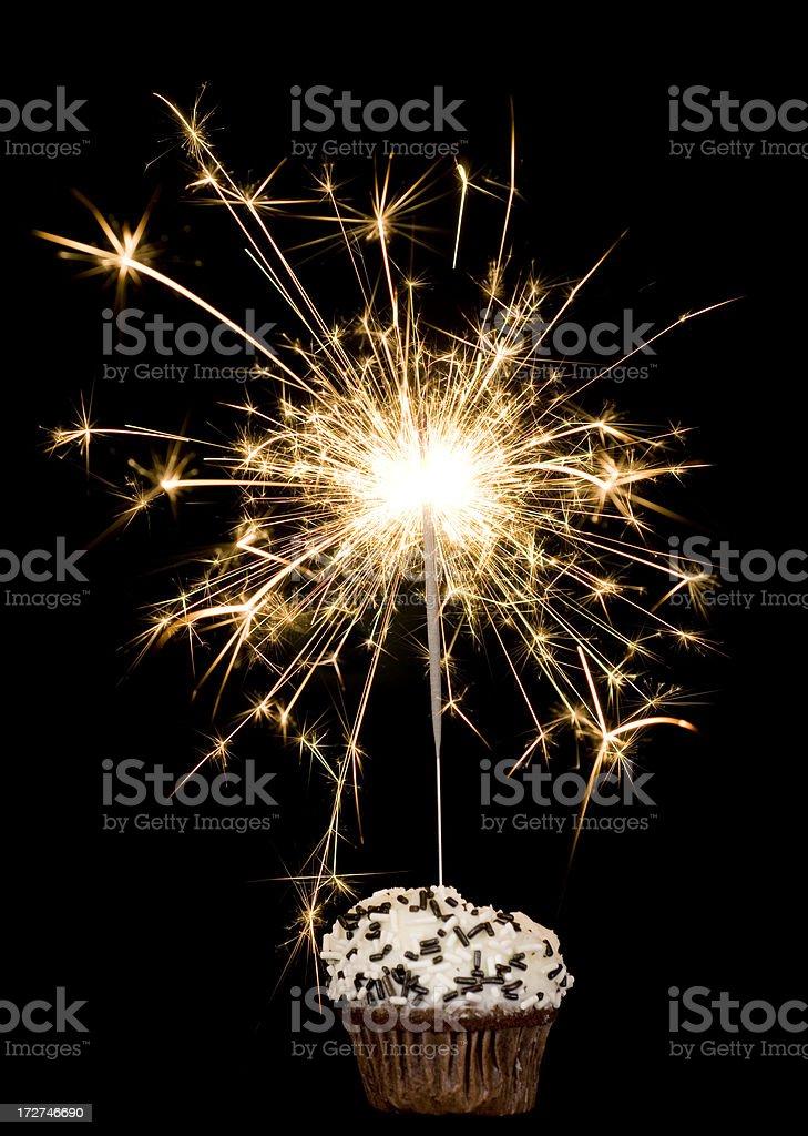Cupcake with sparkler on black stock photo