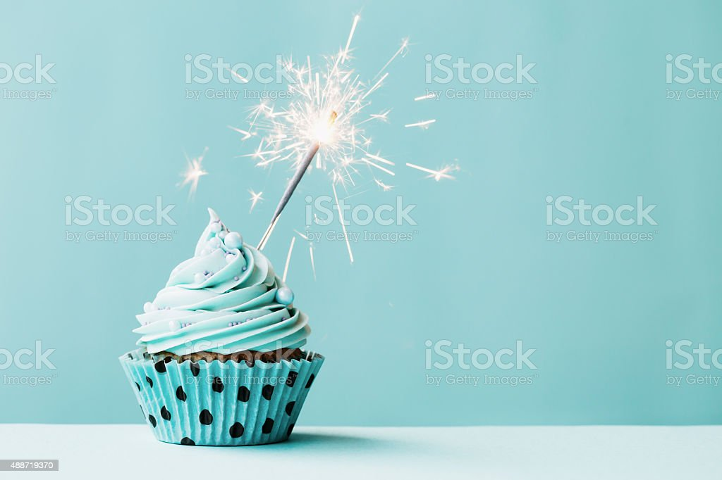 Cupcake with sparkler stock photo
