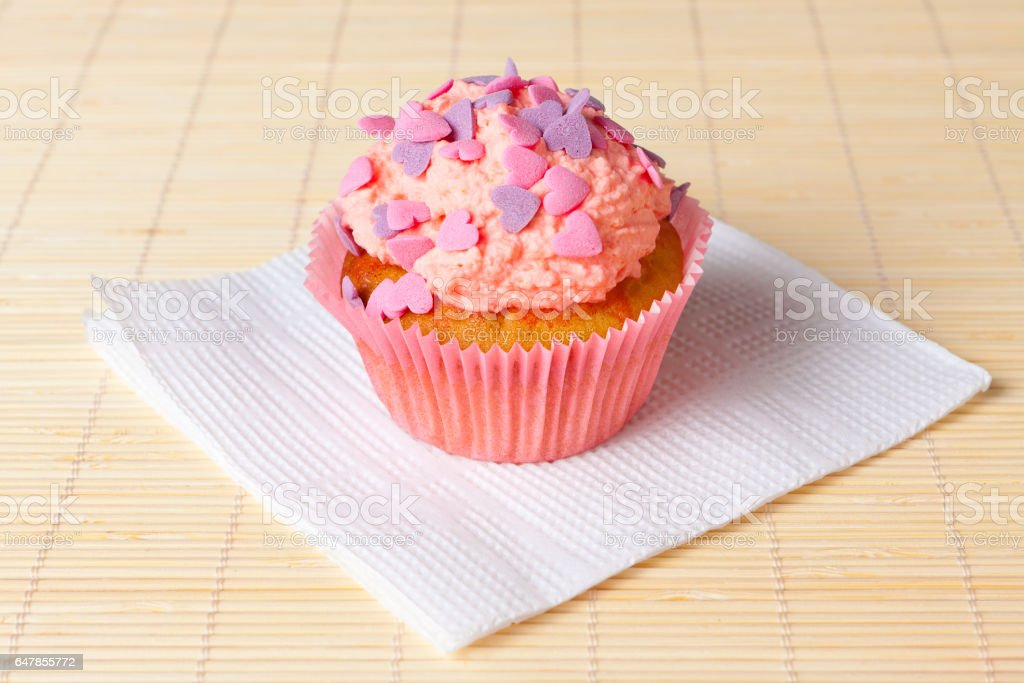 cupcake with topping in the form of hearts stock photo