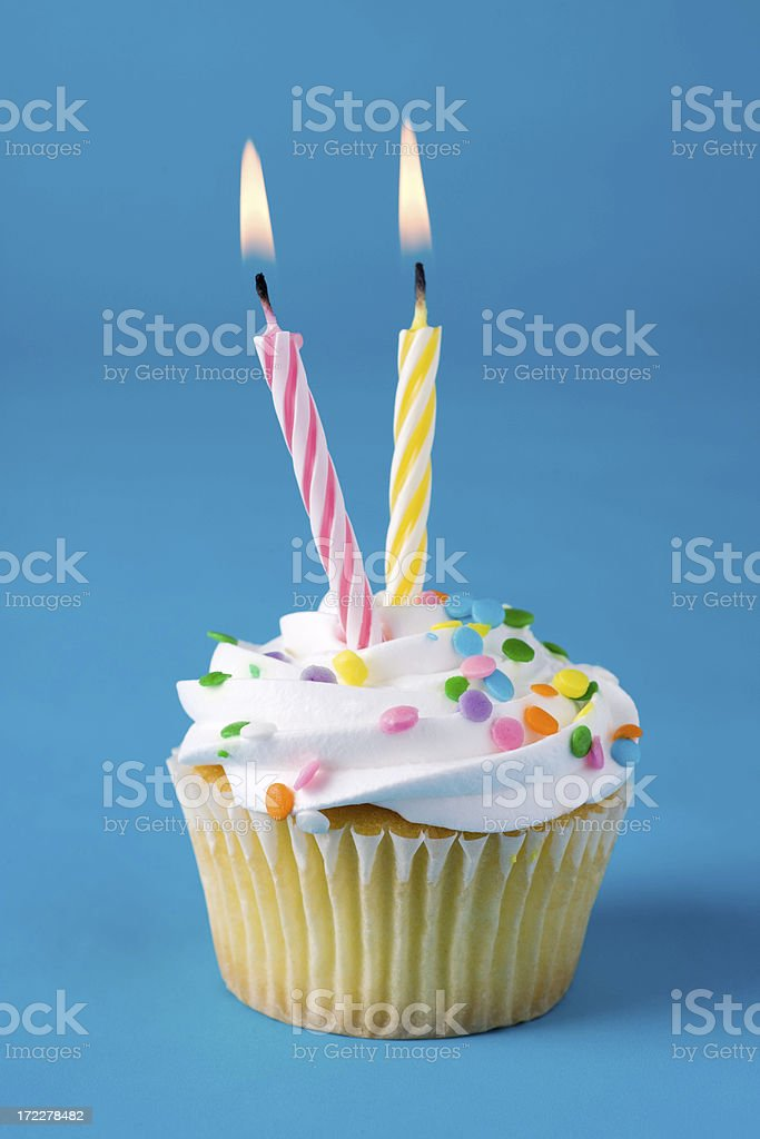 Cupcake with Two Candles royalty-free stock photo