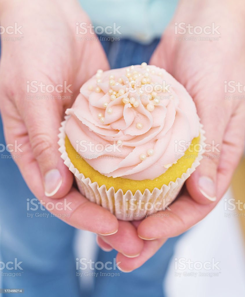 Cupcakes in hands royalty-free stock photo