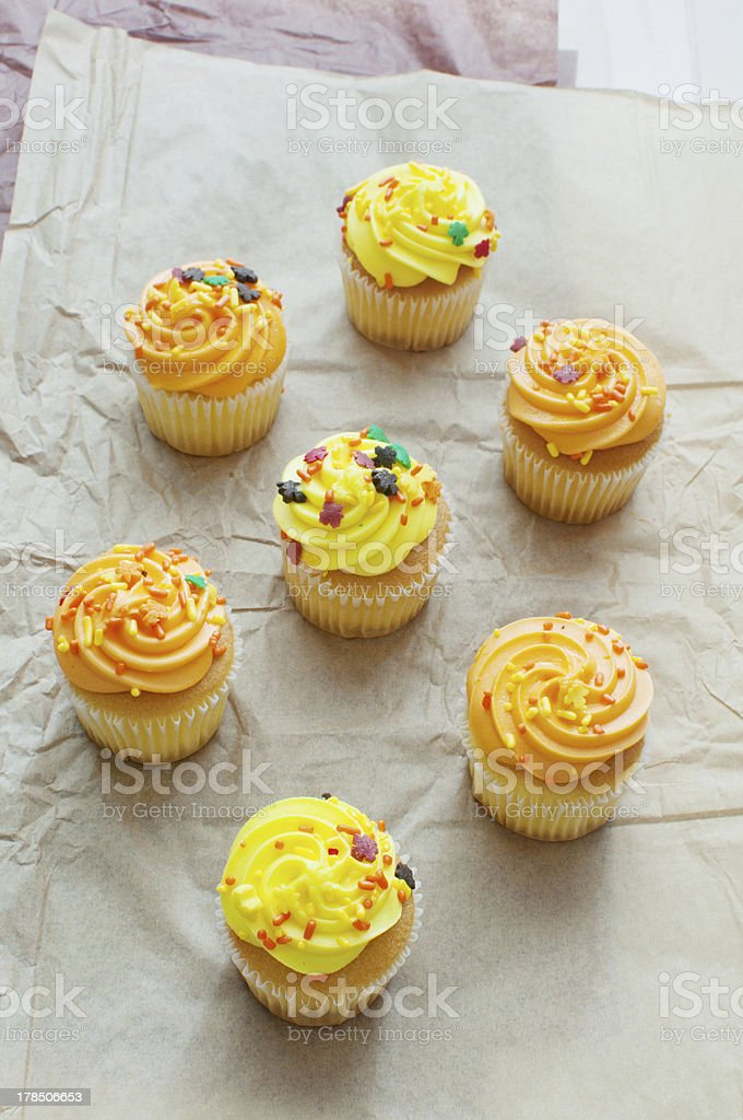 Cupcakes top view with orange and yellow frosting royalty-free stock photo