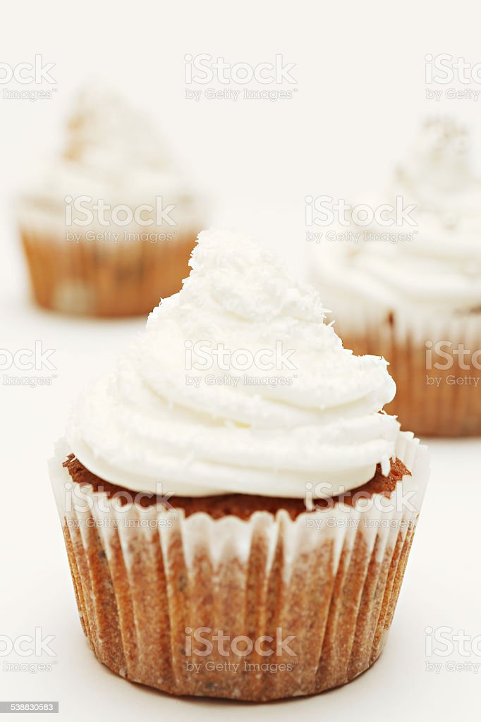 Cupcakes with cream frosting stock photo