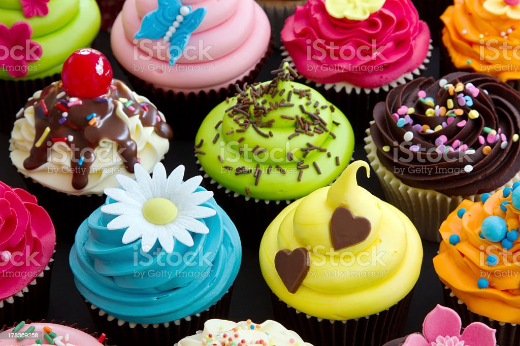Cupcakes with different colored frosting stock photo