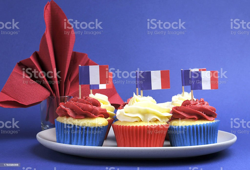 Cupcakes with flags of France and fleur-de-lis red napkin stock photo