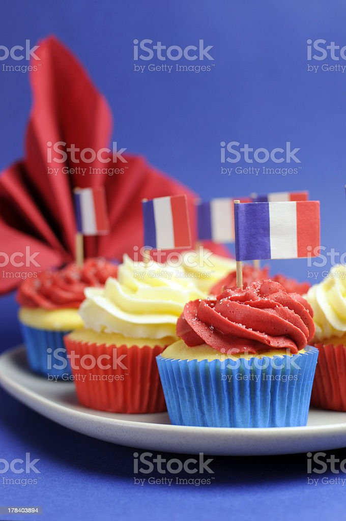Cupcakes with flags of France close up vertical. stock photo