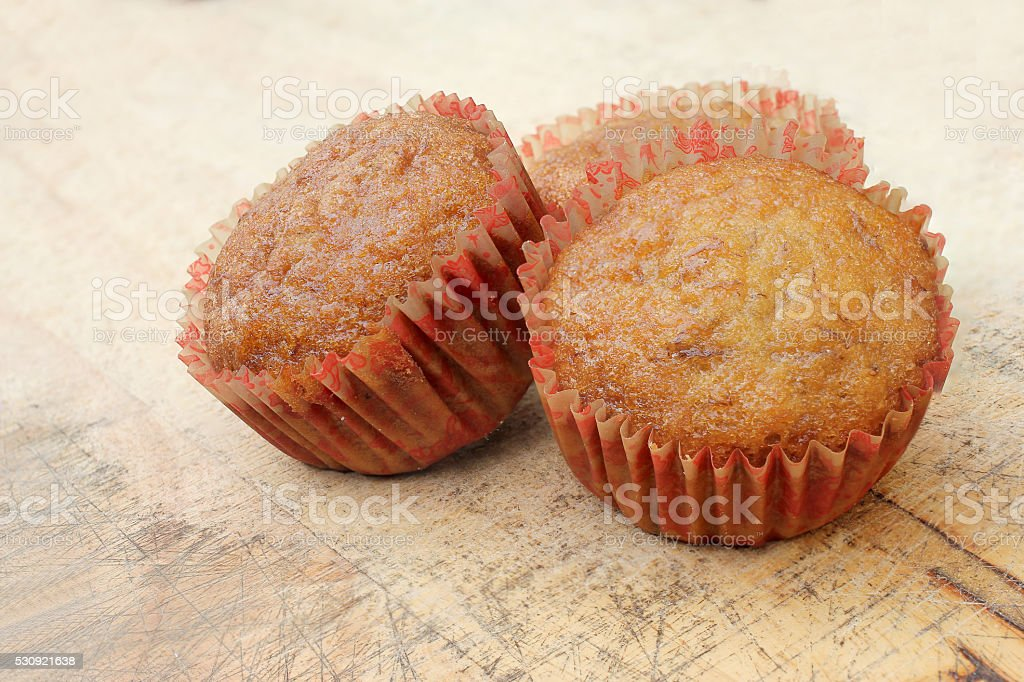 cupcakes with fruit filling on cutting board. stock photo