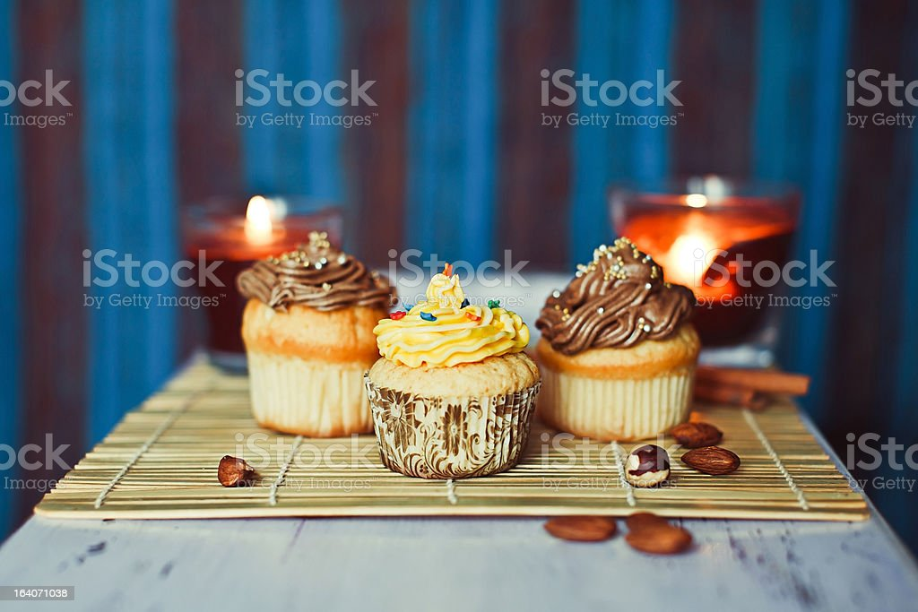 Cupcakes with nuts on the blue background royalty-free stock photo