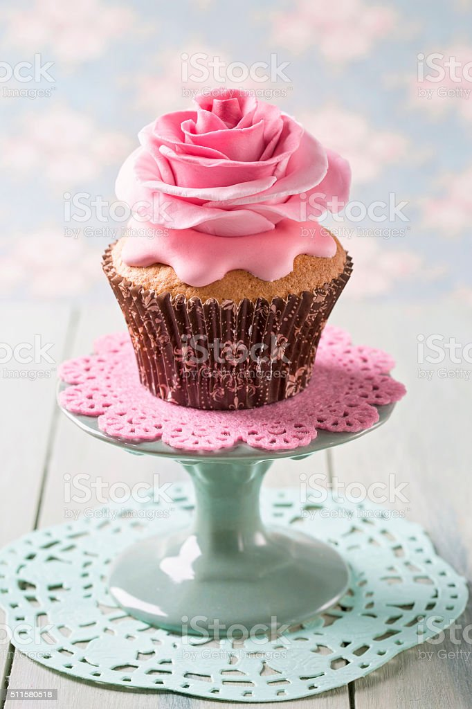 Cupcakes with rose flowers stock photo