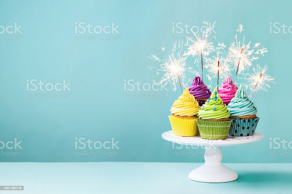 Cupcakes with sparklers stock photo